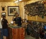 Jeff Sansone mans the archery shop counter, which is a gathering place at the center.